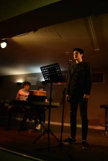 Performing at solo singing evening